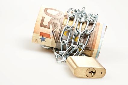 Euro banknotes locked on white